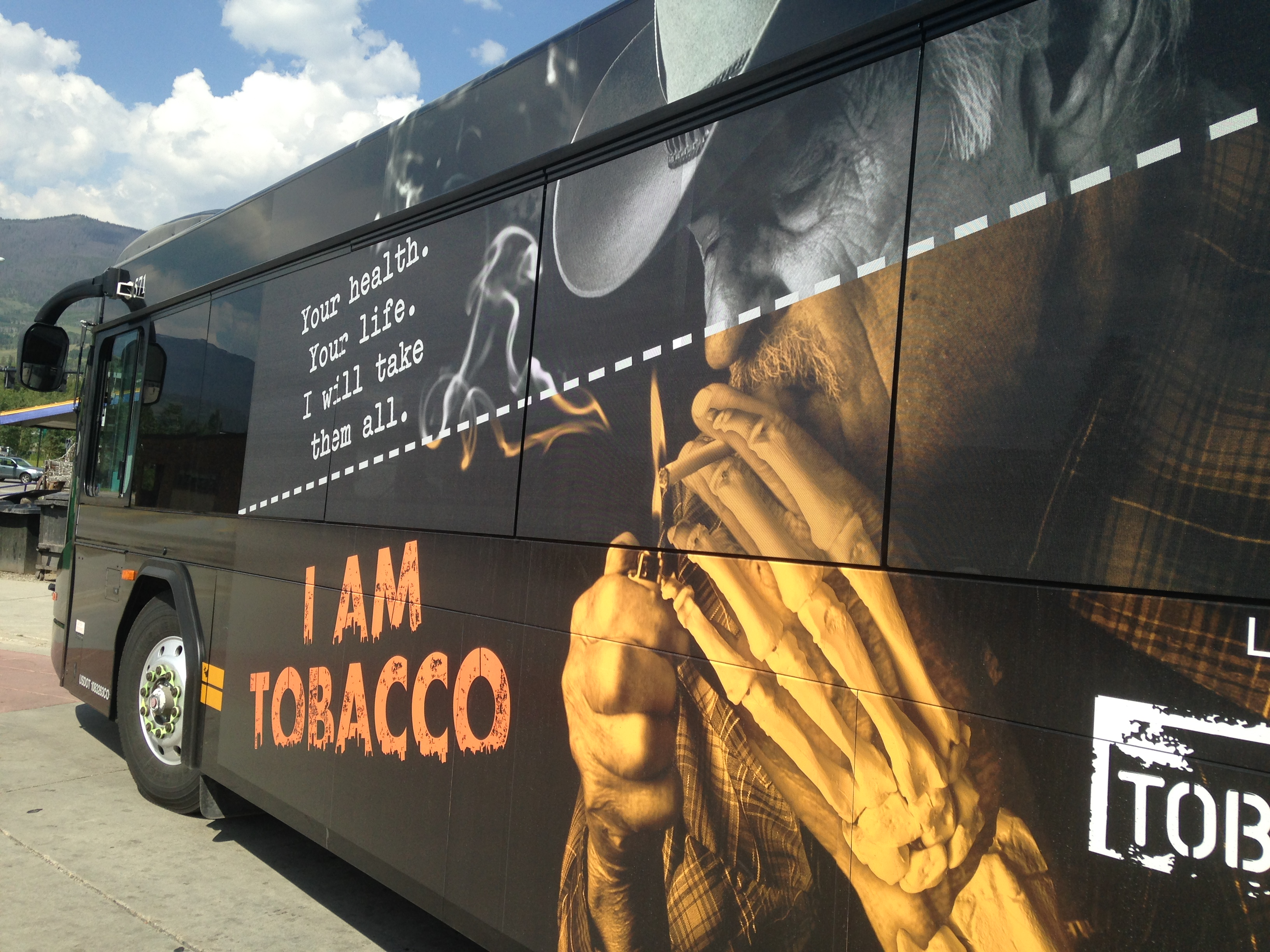 Photo of a bus with an anti-tobacco ad on the side