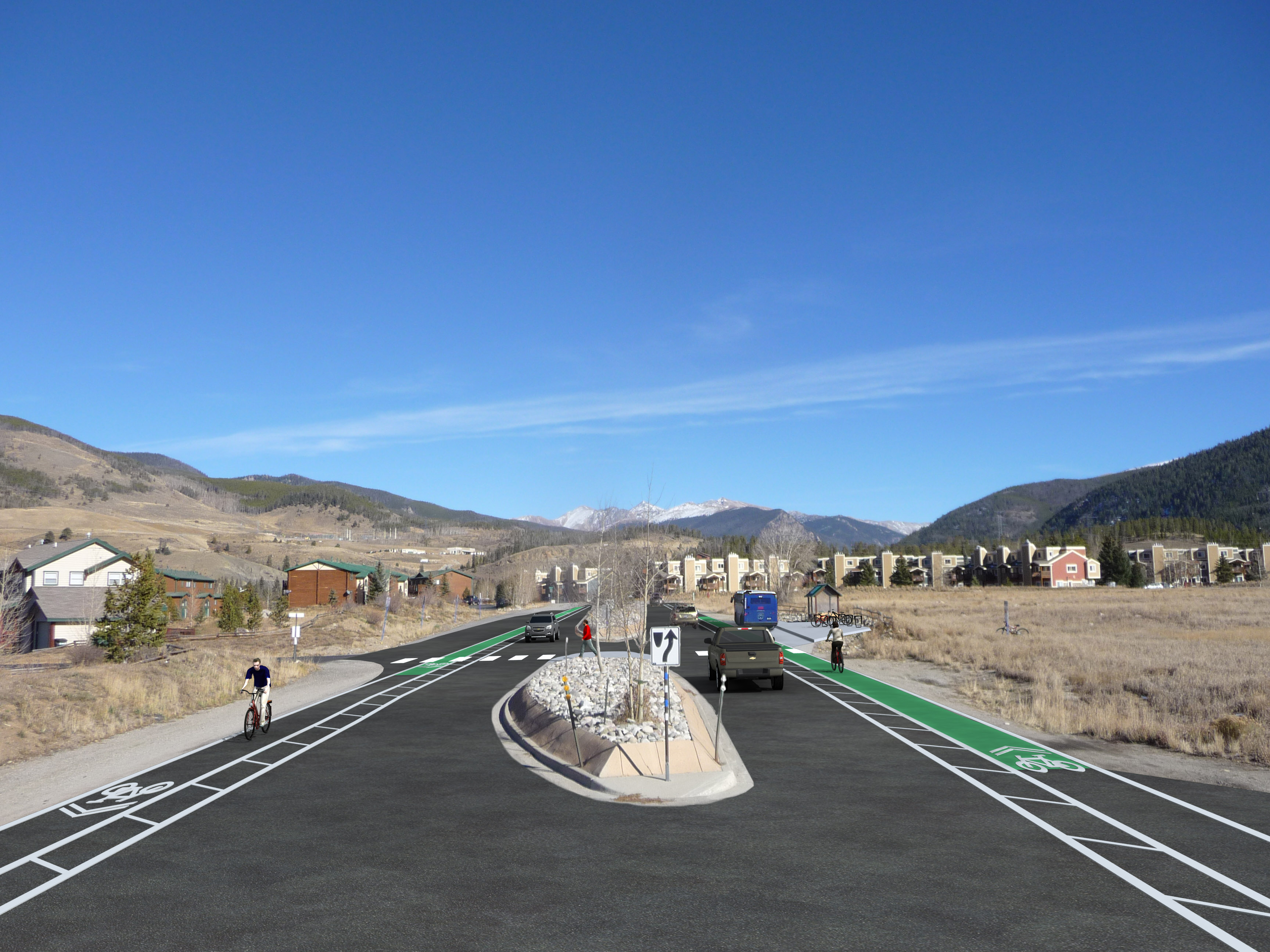 Photo of a road with green bike lanes on either side.