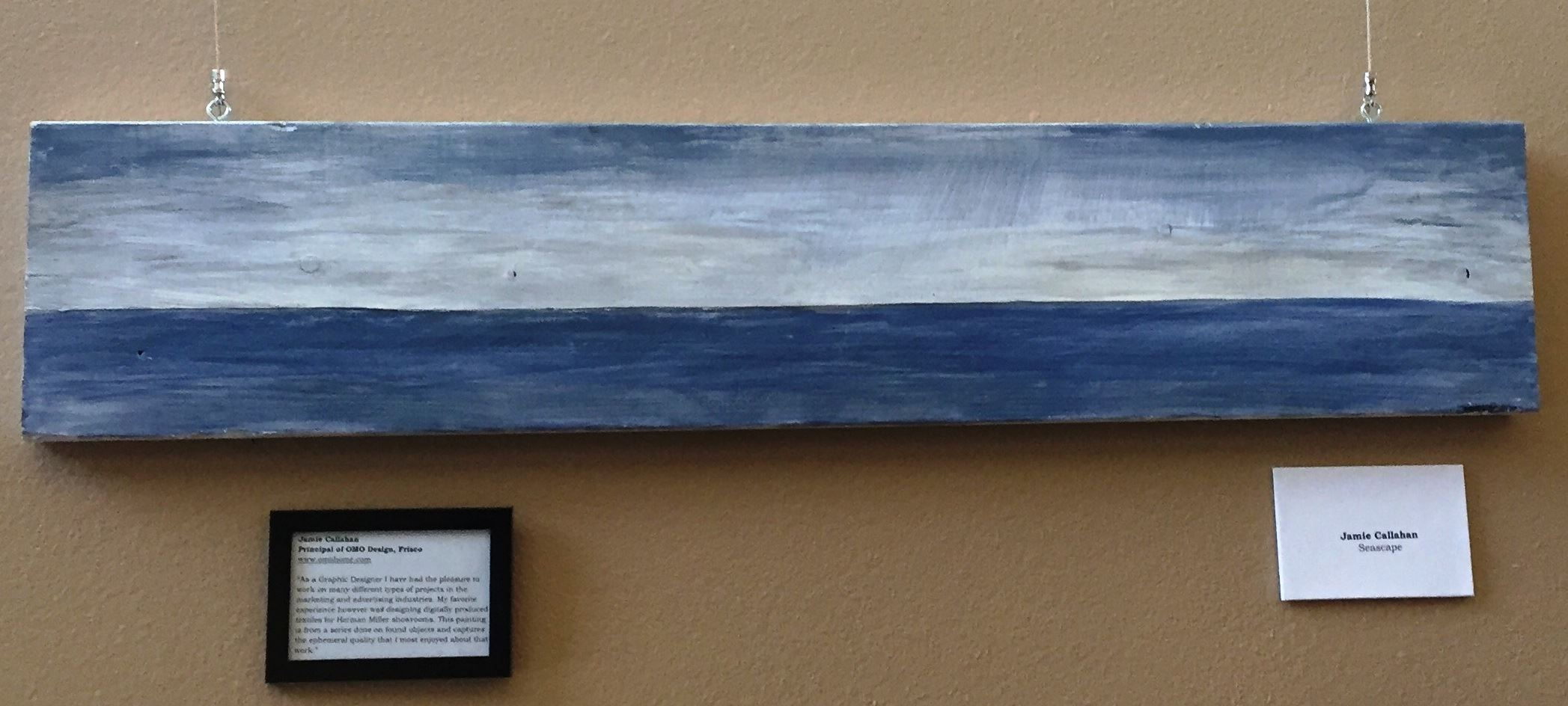 Photo of an abstract painting of the horizon on the ocean.