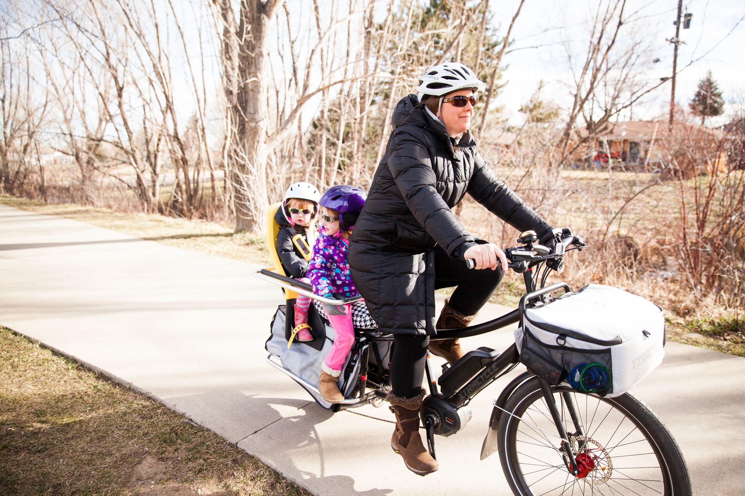 E-bike with Mom and children on paved pathway