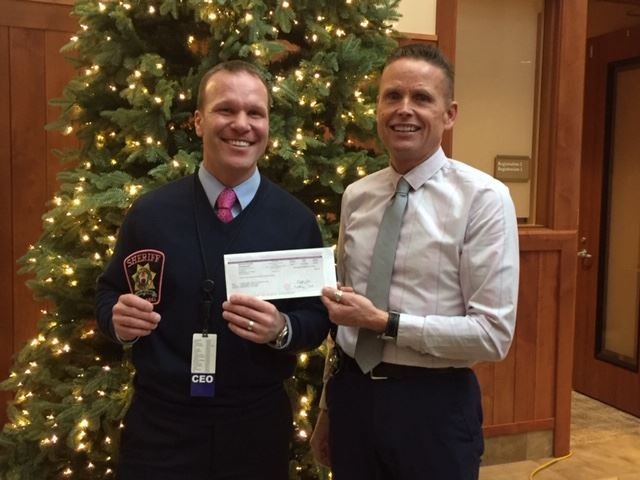 Summit County Sheriff Jaime FitzSimons Presents a check to St. Anthony Summit Medical Center CEO Lee