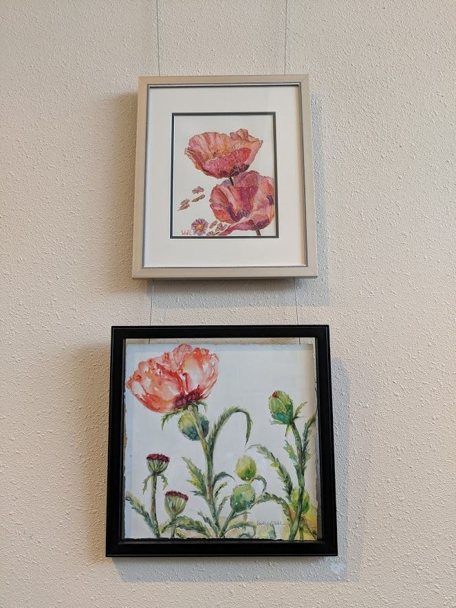 Two framed watercolor paintings of poppies