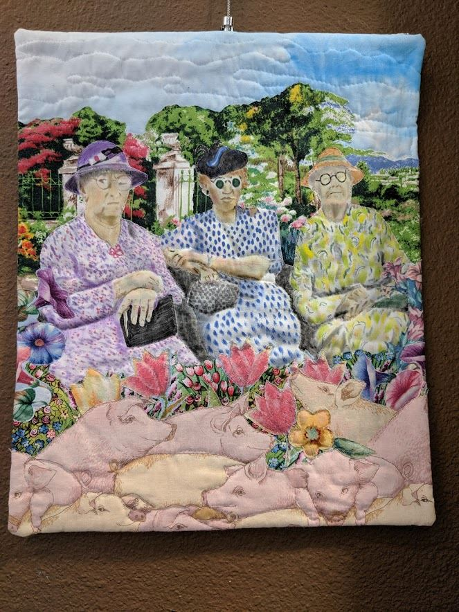 Quilted image of three women and pigs against garden backdrop