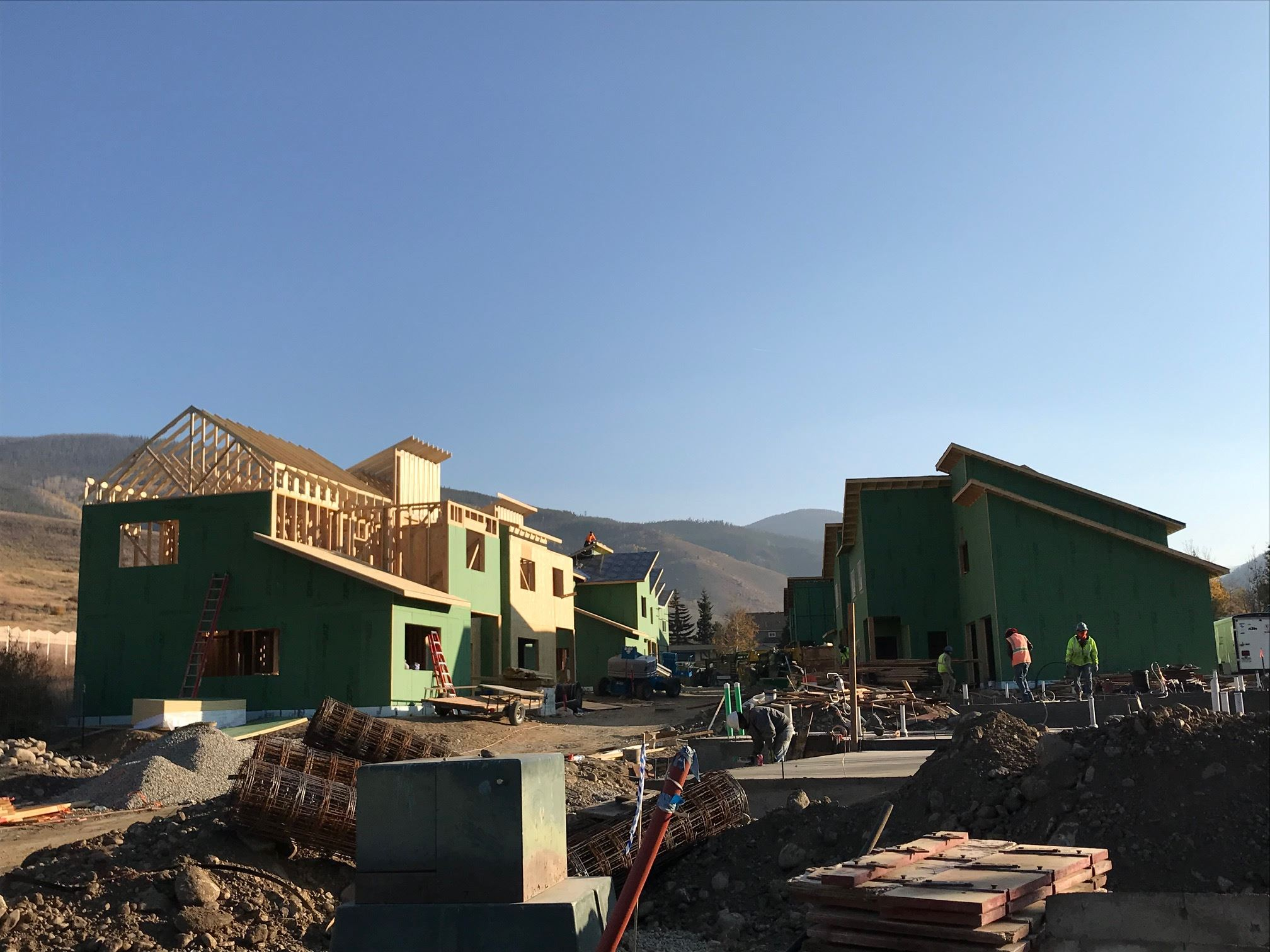 Photo of Dillon Valley Vistas Townhouses under construction, with mountains in background